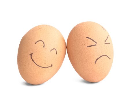 smiley and angry egg on white photo