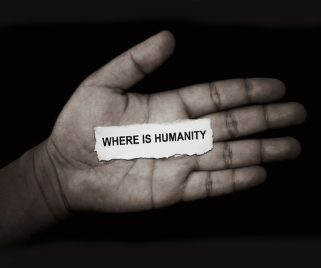 exploitation: the words where is humanity in paper on hand