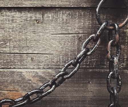 rusty chain: rusty chain and wooden background