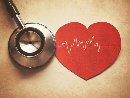 heart and stethoscope in vintage style photo