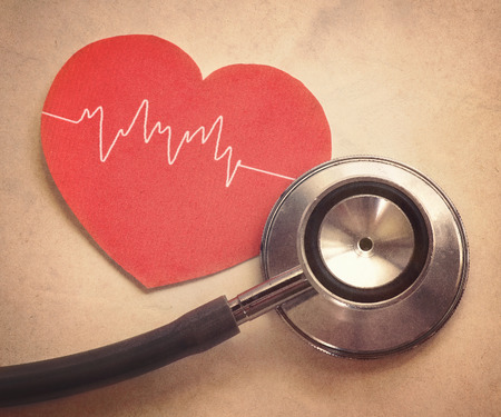red stethoscope: heart and stethoscope in vintage style