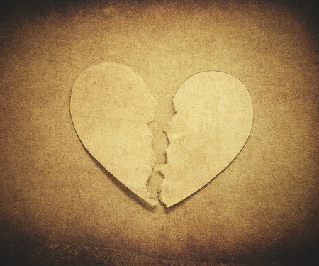 paper heart torn in brown vintage style photo