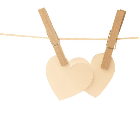 two hearts hanging on rope and white background photo