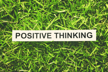 word positive thinking paper on green grass (retro style) photo