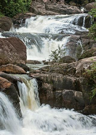 descends: water descends on rock steps Stock Photo