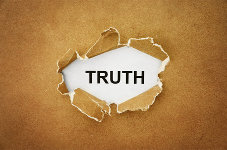 truths: the word  truth  in the hole of brown paper