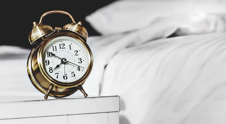 bedsheet: retro alarm clock and bed background