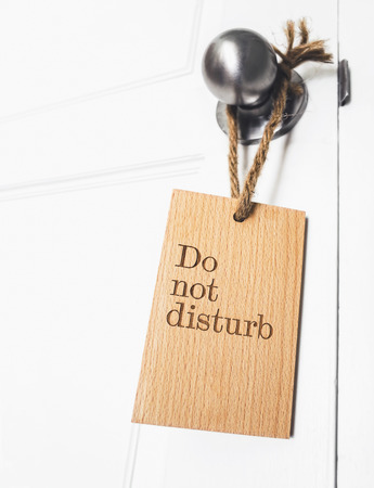 "do: ""do not disturb"" sign hanging on the doorknob"