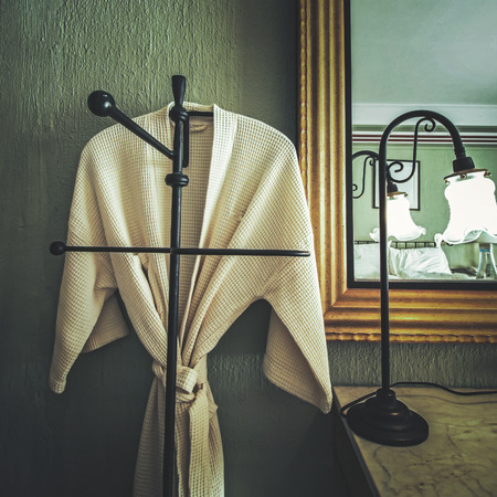house robe: bathrobe hanging in the room in vintage style Stock Photo