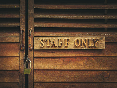 staff only: staff only sign and wooden locked door