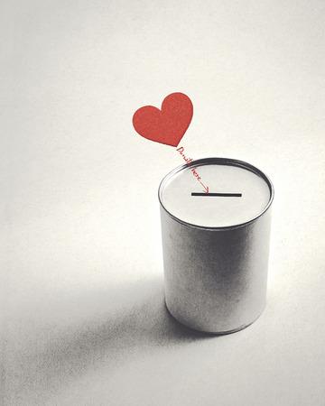 heart symbol and donation can (retro style) Foto de archivo