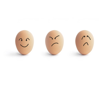 different emotion of eggs over white background photo