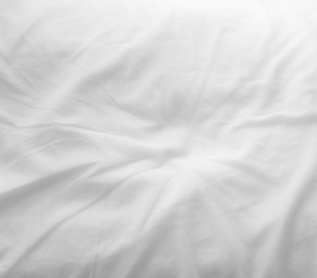 bed sheet: soft white bed sheets background Stock Photo