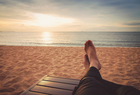 man relaxing on the sunset beach (retro style) photo