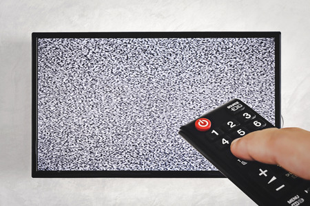 remote control television with white noise screen