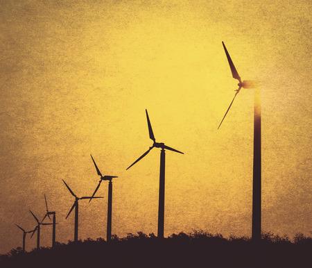 wind turbines silhouette background (retro style) photo