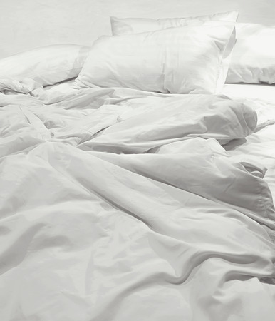 bed: messy bed sheets and pillow Stock Photo