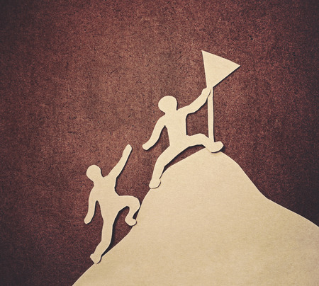 helping together to success (papercut with grunge background) photo