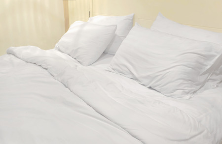 bed sheets: soft white bed sheets and pillows