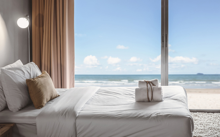 hotel suite: relaxation in bedroom with seaview Stock Photo