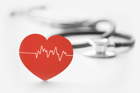 medical tools: heart symbol and stethoscope on white
