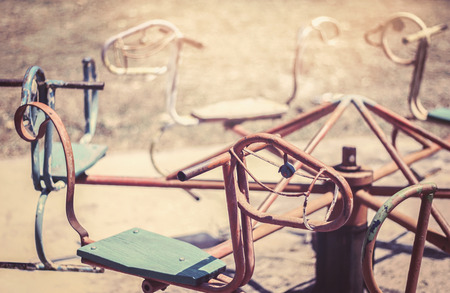 play the old park: old carousel in playground with vintage filter Stock Photo