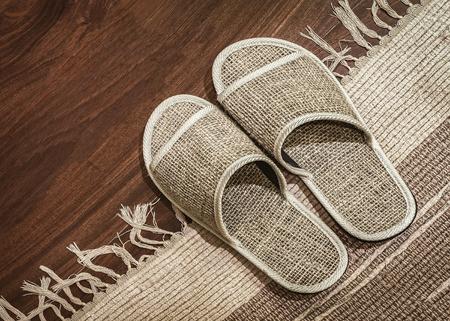 rug texture: hemp slippers on the floor Stock Photo