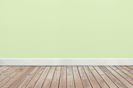 soft green wall and wooden floor Stockfoto