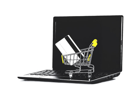 online shopping (a shopping cart with credit card on laptop) Zdjęcie Seryjne