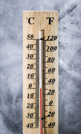 thermometer on ice texture background