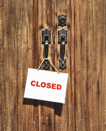 closed sign: closed sign on wooden door