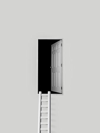darken: ladder and door into the dark Stock Photo
