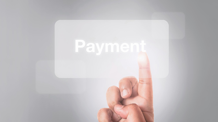 banking concept: online banking concept, hand pressing payment button with gray background