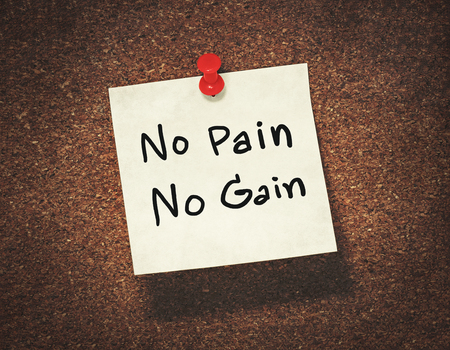 gain: no pain no gain on paper notepad Stock Photo