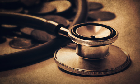 business finance (stethoscope with coins in retro filter) Stock Photo