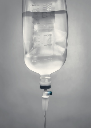 chemotherapy: still life of infusion bottle with gray background