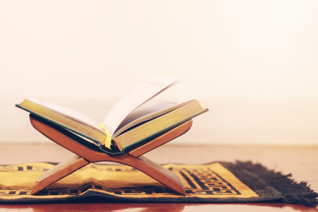 Quran, the holy book of islam on wooden stand