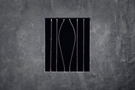 prison escape (bent metal bar) Stok Fotoğraf