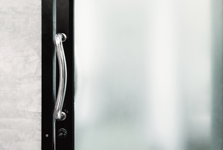 handle and lock of frosted glass door Imagens