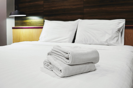 white clean towels prepared on bed