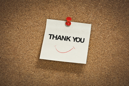 thank you word with smile symbol on notepad 版權商用圖片