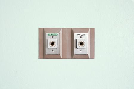 oxygen and vacuum plug on the wall Reklamní fotografie