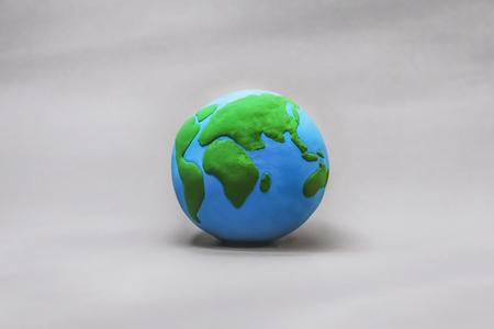 a clay globe on gray background 版權商用圖片