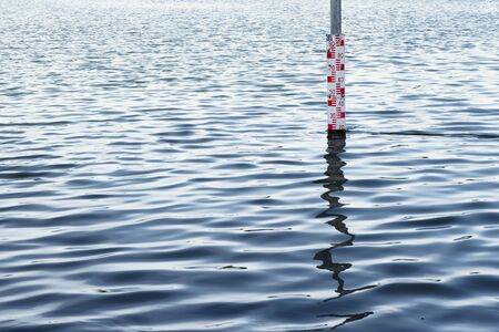 water level measurement sign on water