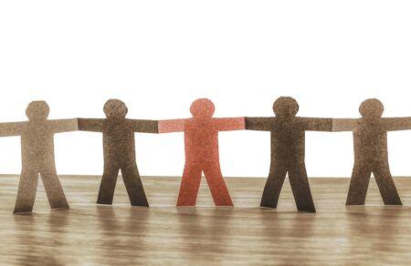 leadership in team. paper cut people symbol