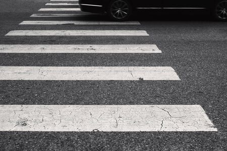 car passing over crosswalk on the street. stop for pedestrian Stock Photo