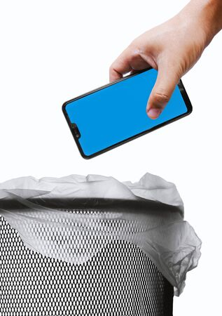 throwing away a mobile phone in a bin