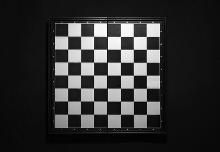 empty chess board on black background Standard-Bild