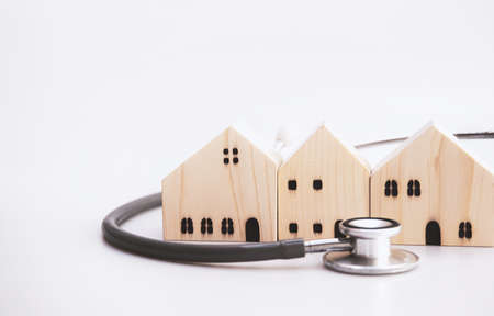 Home appraisal. House care and safety. village maintenance services. Real estate inspector. Property value estimate. Checking and consultant concept. House models with stethoscope on white background.