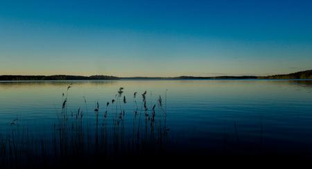 beautiful sunset scenery at saimaa lake in finland